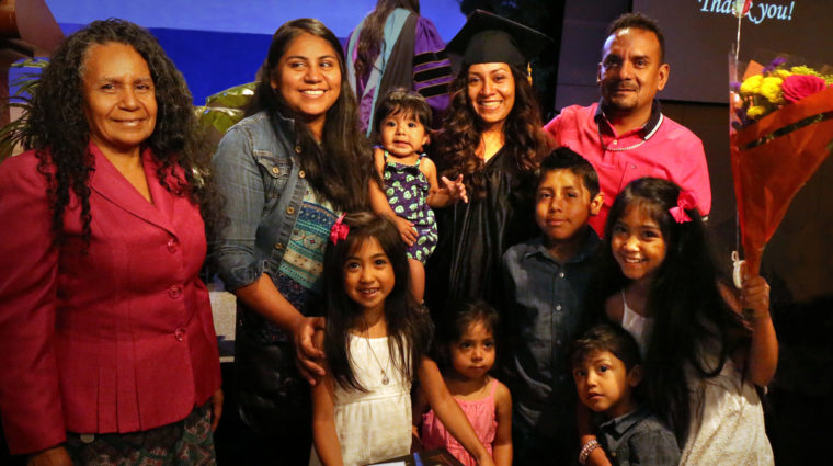A family celebrates at the YWCA Family Literacy Center graduation.