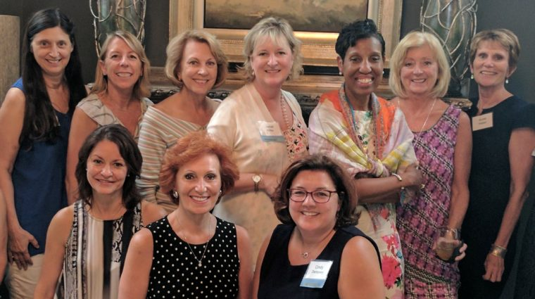 Women from the YWCA's Fulcrum society gather at a member's home